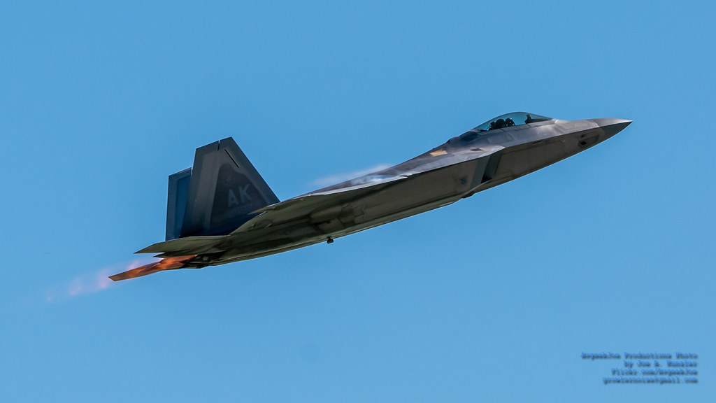 RAPTOR IN BURNER CLIMBING INTO THE BLUE