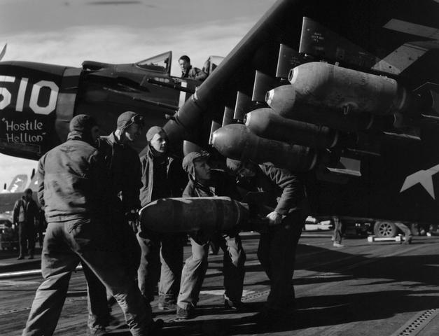 AD-4 Skyraider being uploaded with bombs circa 1953