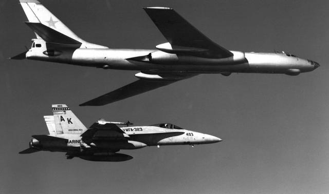 TU-16C of AV-MF and F-18A of VMFA-323