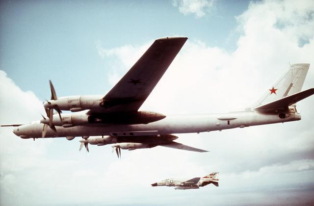 TU-95 Bear E intercepted by a USN F-4J of VF-31