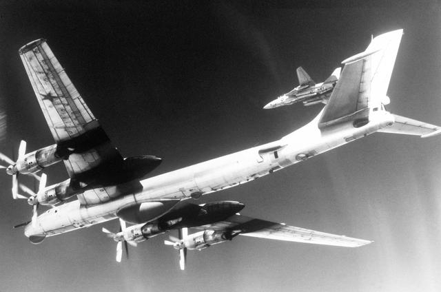 Underside of a TU-95D being intercepted by a F-14A