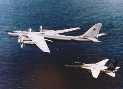 TU-95 Bear D intercepted by a F-14A of VF-154