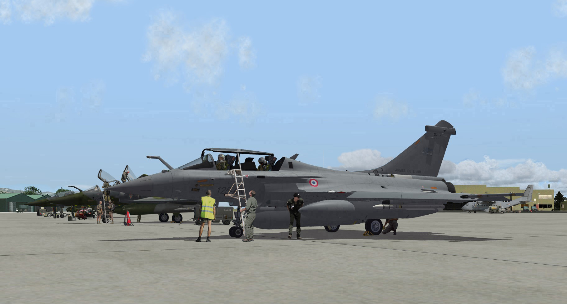 2011 Rafale B after landing, alongside Mirages 2000D being prepared for a mission.