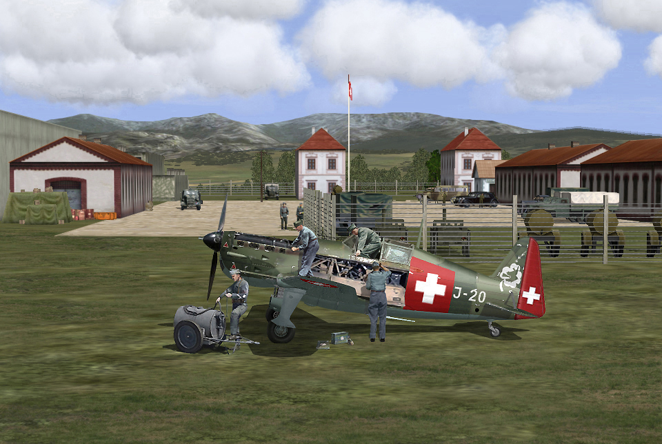 Swiss 05/1940 Mechanics working on a MS406 under spring sun