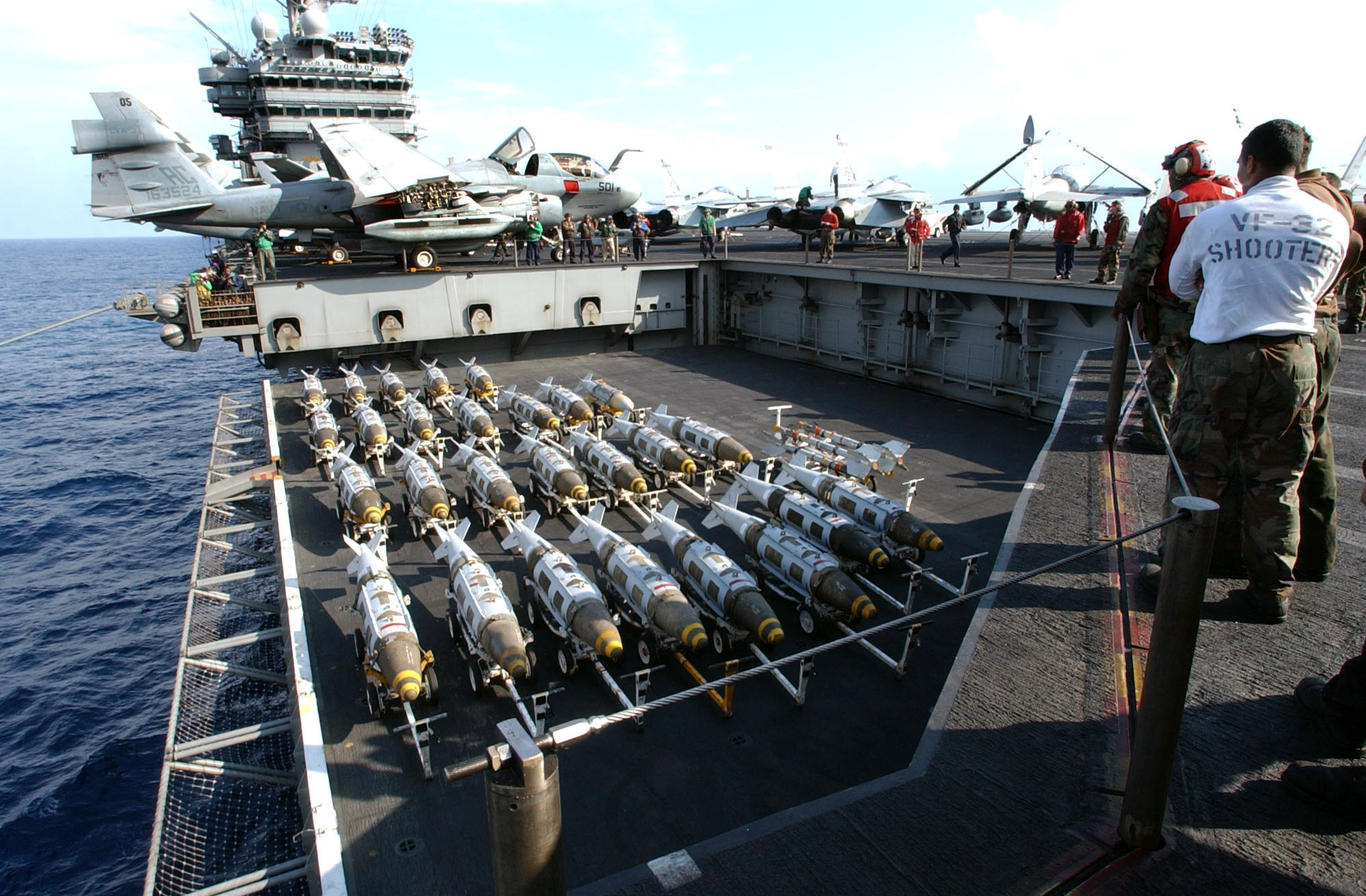 JDAM munitions being brought on deck.