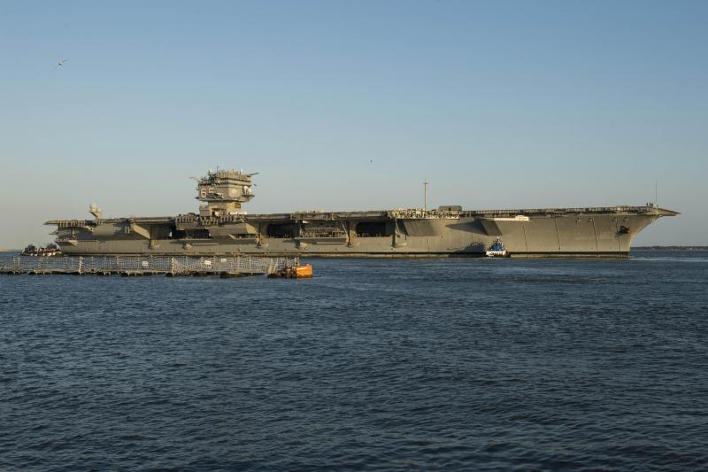 USS_Enterprise_(CVN-65)_being_towed_to_Newport_News_for_dismantling_2013.jpg