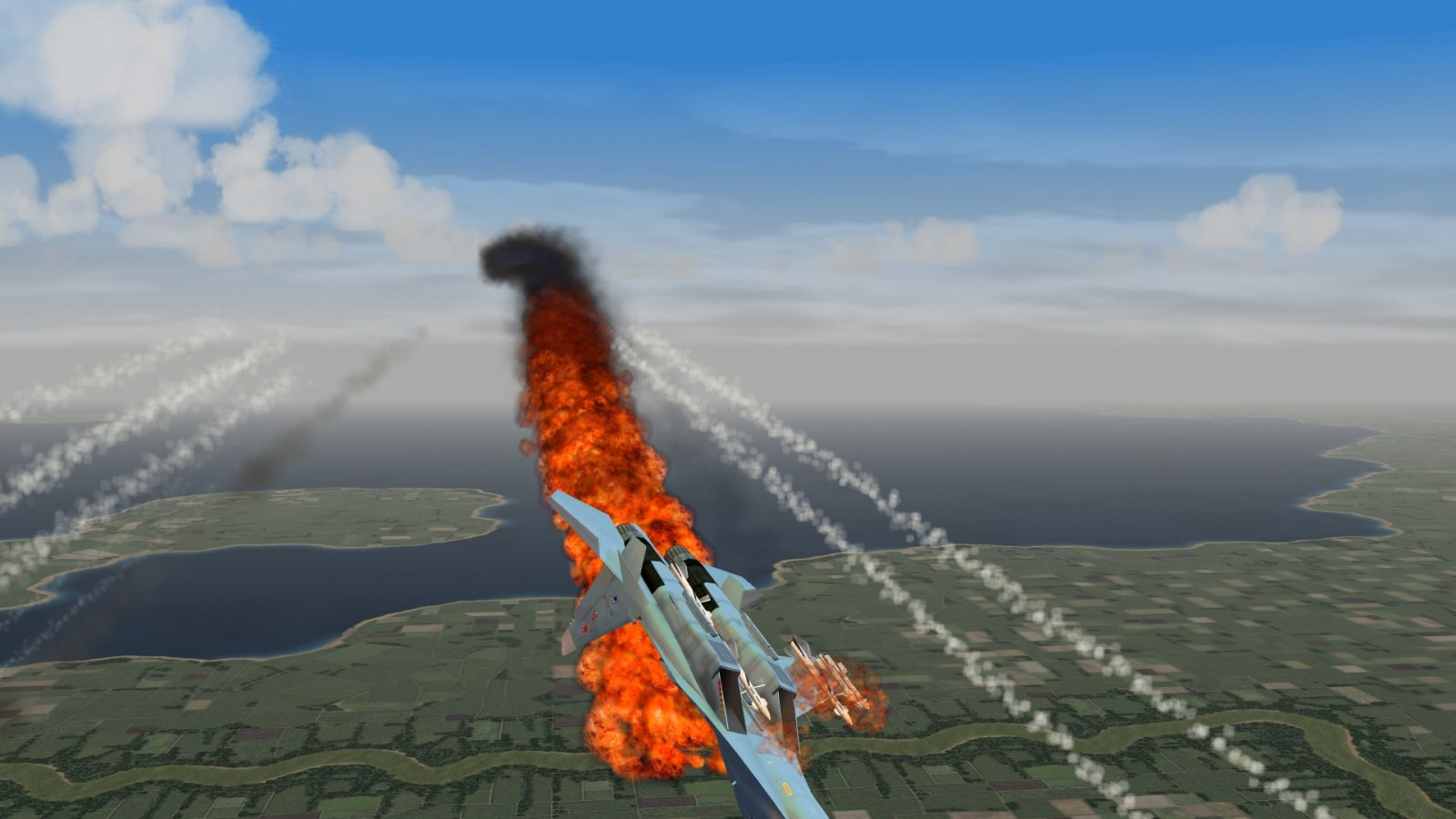 Burning Flanker With Flares Falling Around